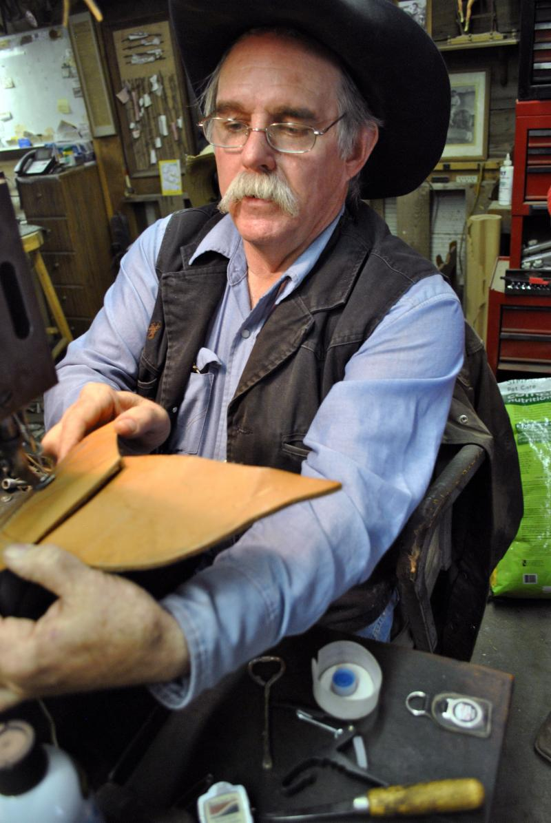 COLLECTOR AND CRAFTSMAN J. W. Beeson creates a custom saddle.