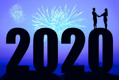 Blue night with fireworks and new year 2020 and couple in love as symbol for wedding and honeymoon