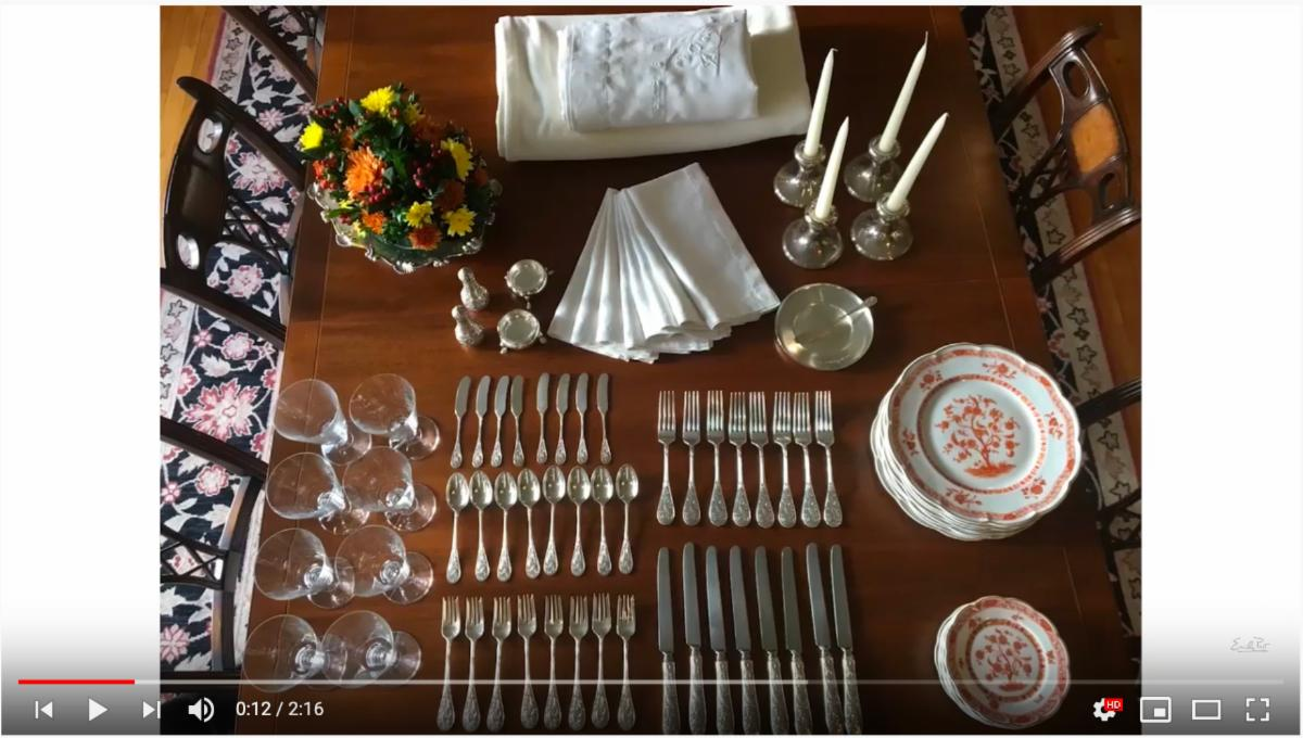 A screenshot from the table setting video showing all the table ware needed