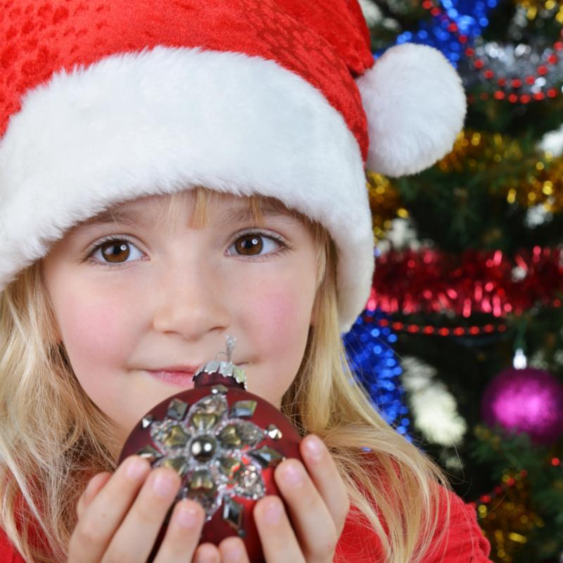 girl_by_christmas_tree.jpg