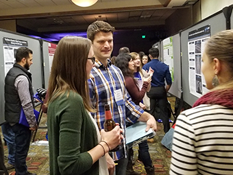 VOS 2019 Conference participants at poster session