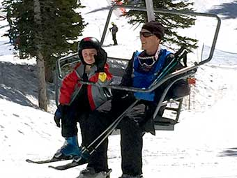 Father and son on the ski lift at Snowbird