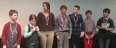 Children and teens with ski race medals