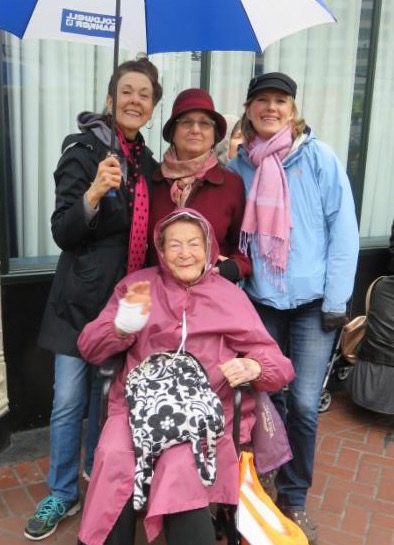 95 year old senior with friends at march