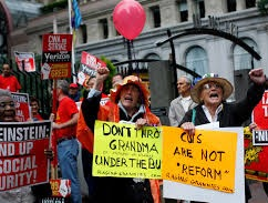 crowd of older people protesting with signs reading _don_t throw grandma under the bus__ and  _cuts are not reform_