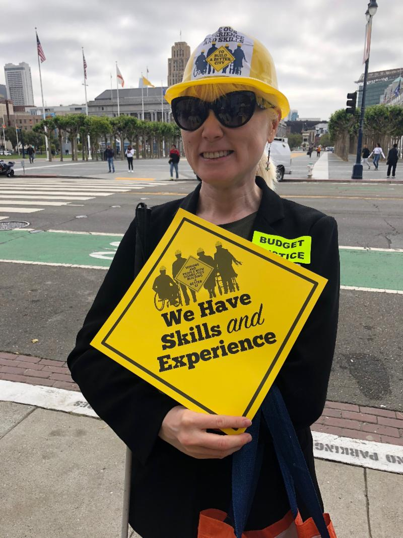 woman with sign that says we have experience and skills