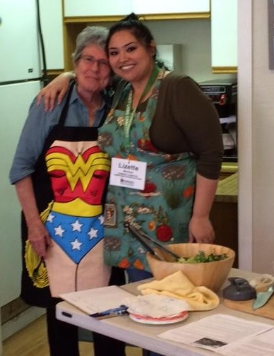 Lizette and Marcia (as Wonder Woman) at a Healthy Aging Cooking Class