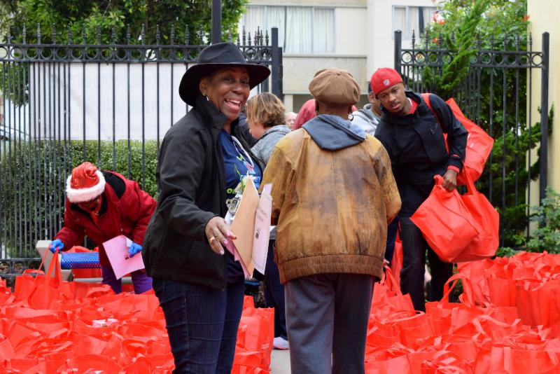 woman organizing delivery of red Glide bags