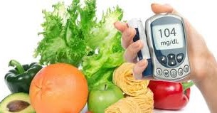 fruits vegetables and a diabetes tester