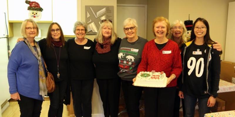 birthday party celebrants iwth cake
