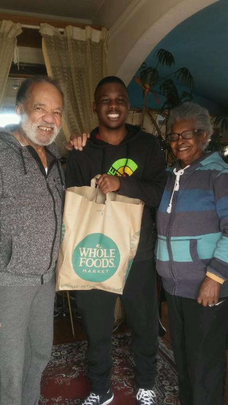 young man with seniors delivering food