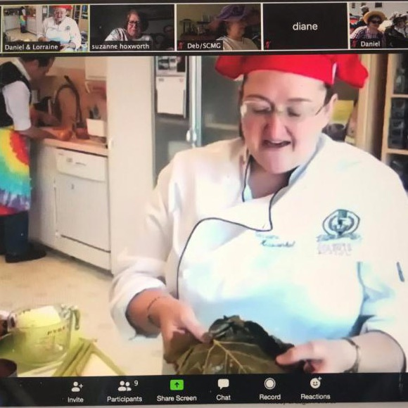 woman chef cooking on Zoom screen