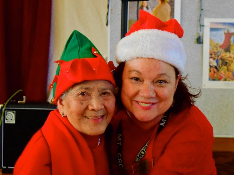 Patti and Carmelita in holiday hats
