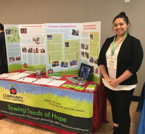 Lizette standing in front of a CLC display
