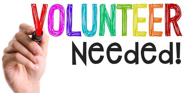 hand holding words volunteer needed_