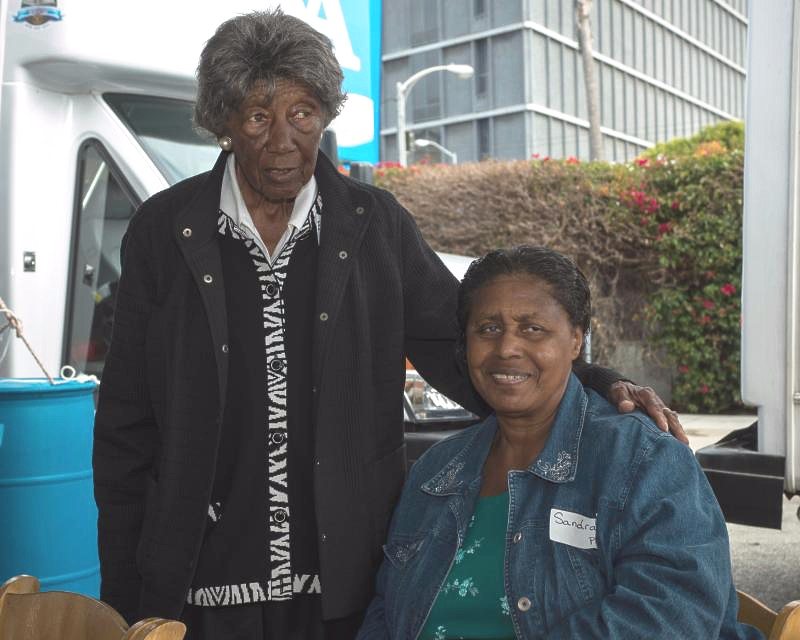 two seniors helping each other access transportation