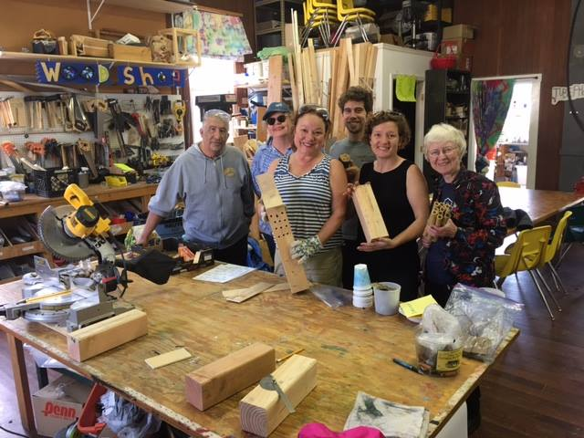 Cayuga members with bee boxes in a workshop