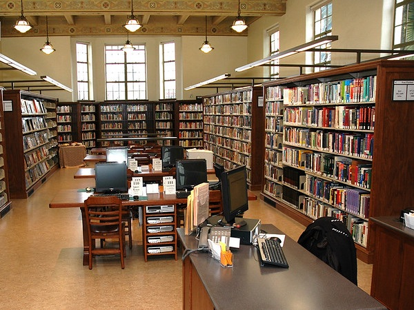 image of a library room with books and tables