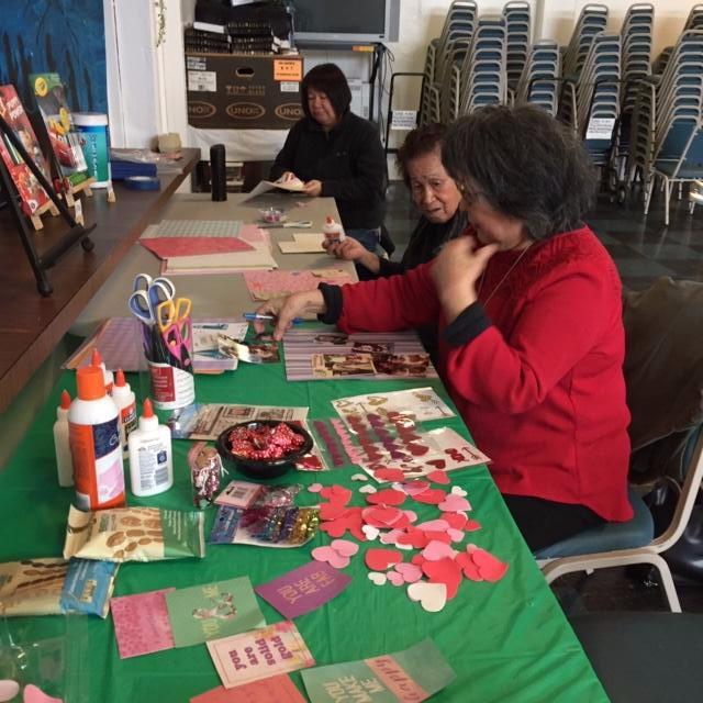 women making Valintine_s Day crafts