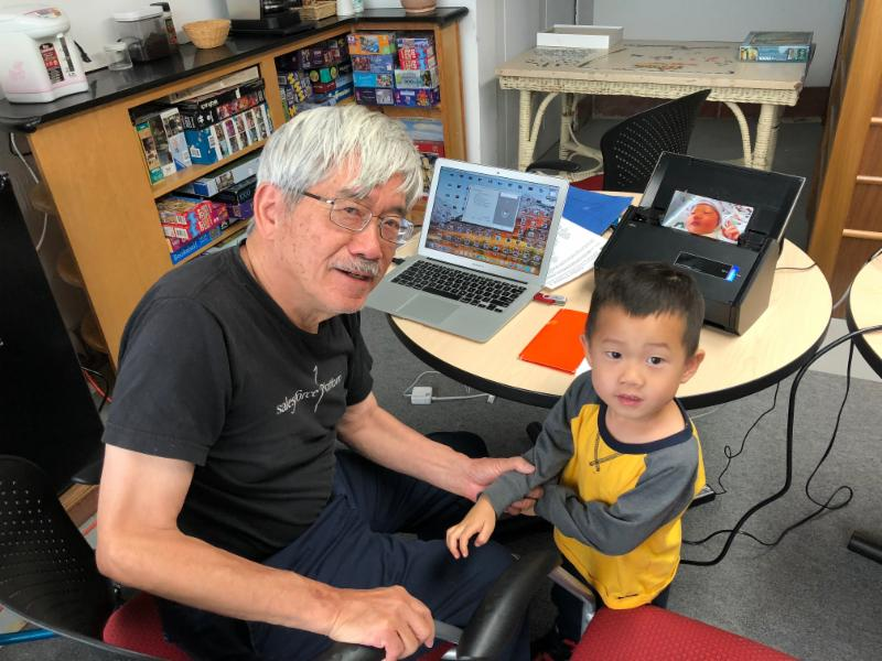 man and grandson scanning