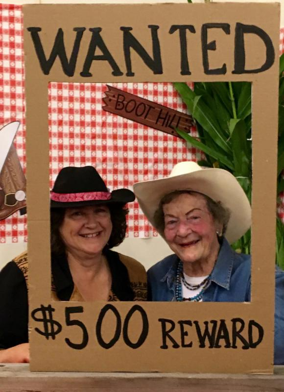 picture of two seniors in a sign that says Wanted _500 Reward