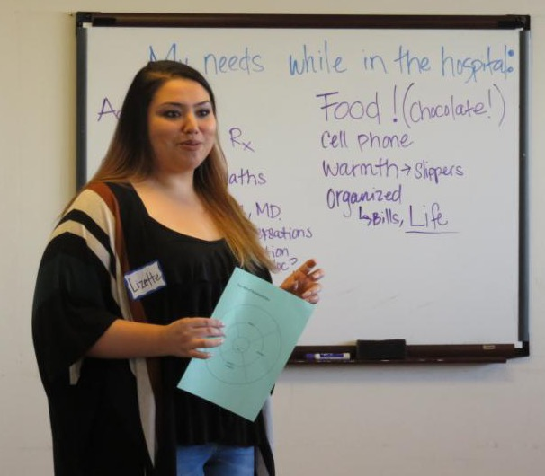 Lizette with words on whiteboard behind her