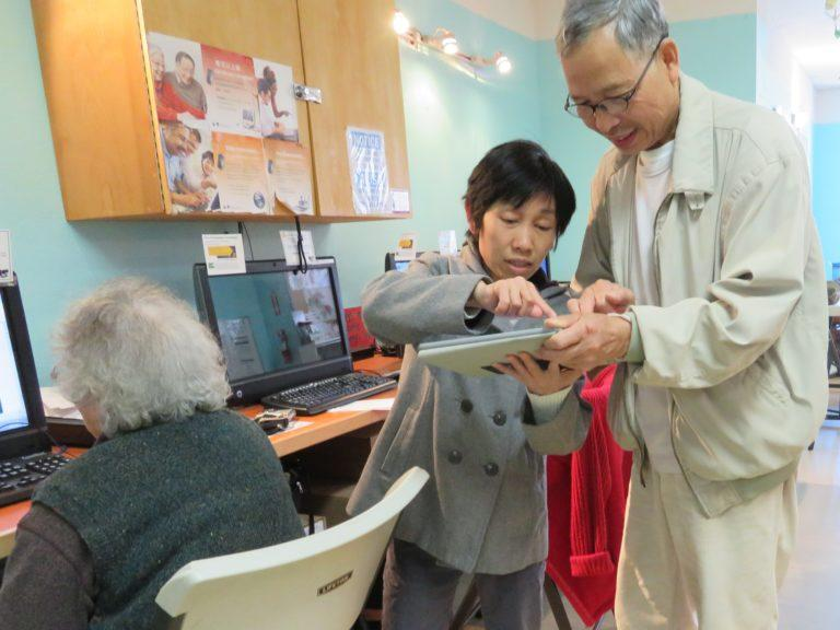 tutor helping senior with tablet