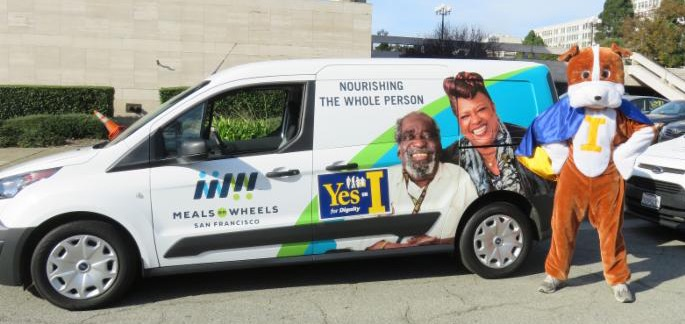 Meals on Wheels truck with signs and Dignity Dog