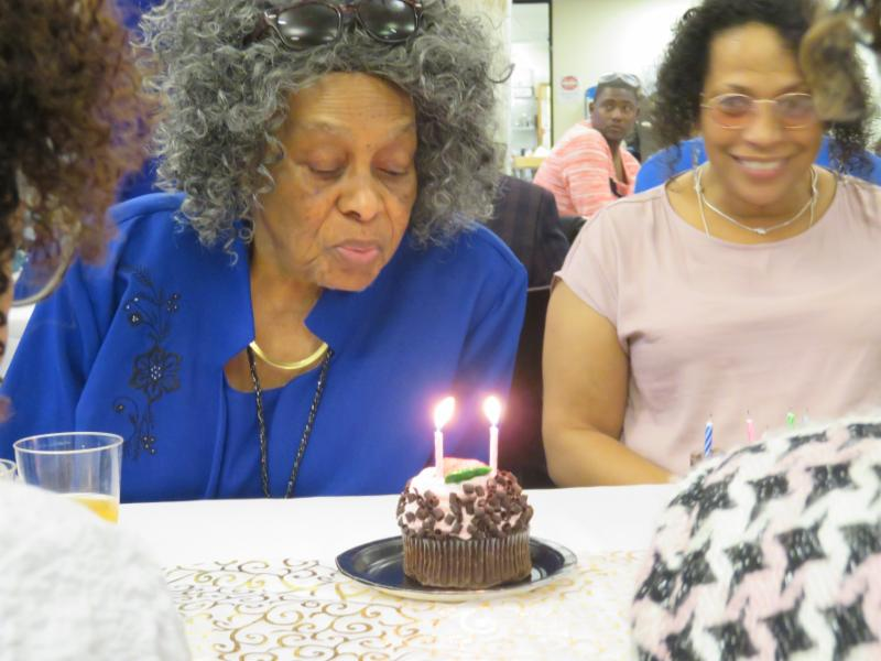senior blowing out birthday candles