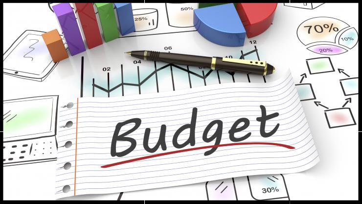 Budget stock image with pen and 3-D graphs
