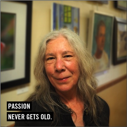 Passion Never Gets Old. Picture of older woman in front of gallery wall
