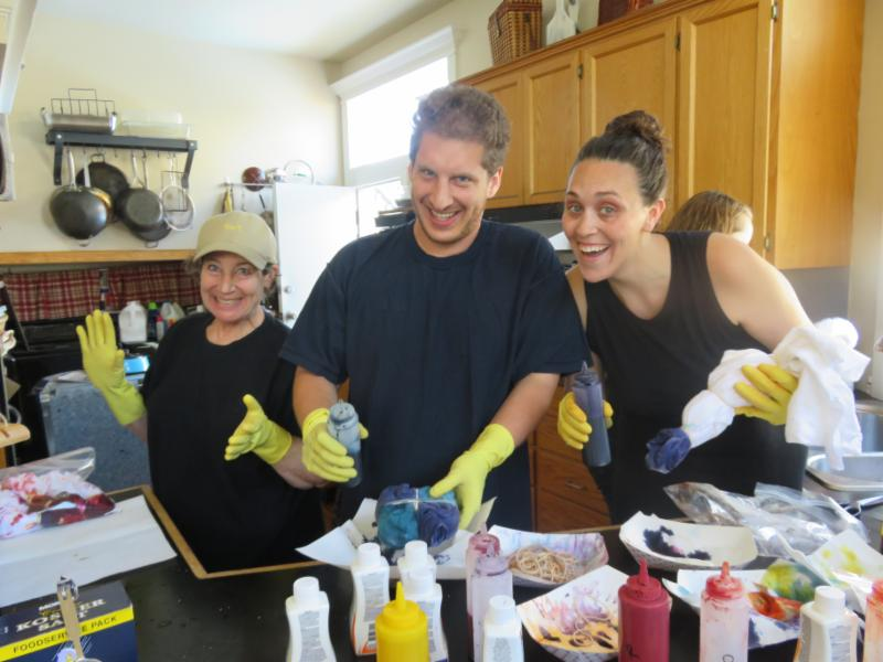 tie dye volunteers with rummer gloves and a big mess