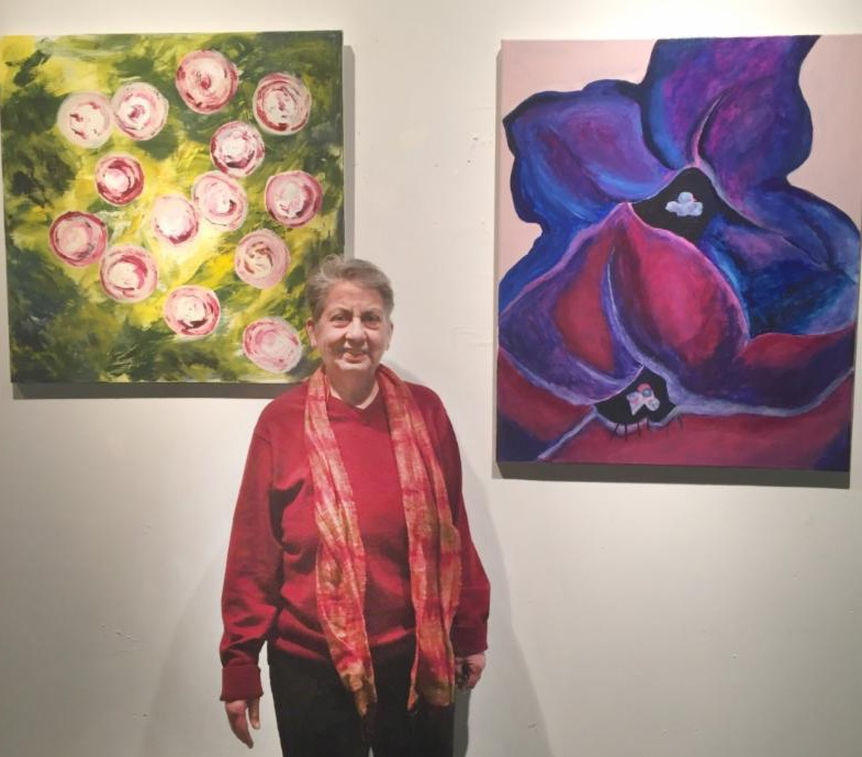 woman in front of art work
