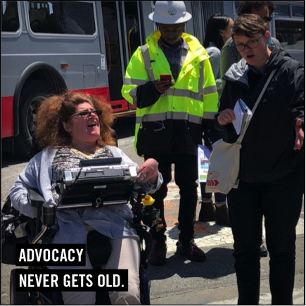 Advocacy Never Gets Old. Picture of Jennifer and two officials talking about safe sidewalks