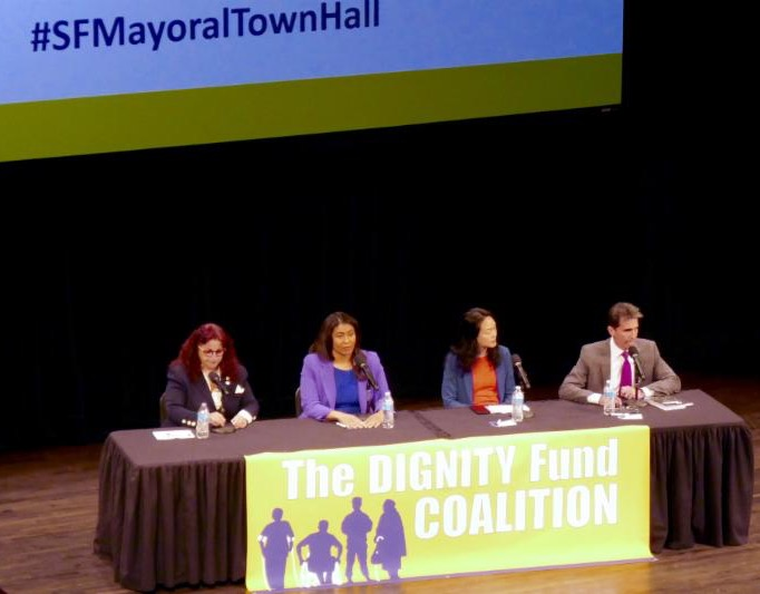 4 candidates at table in front of DFC banner