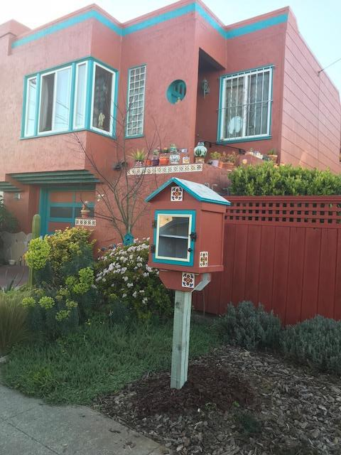 little book library in front of home