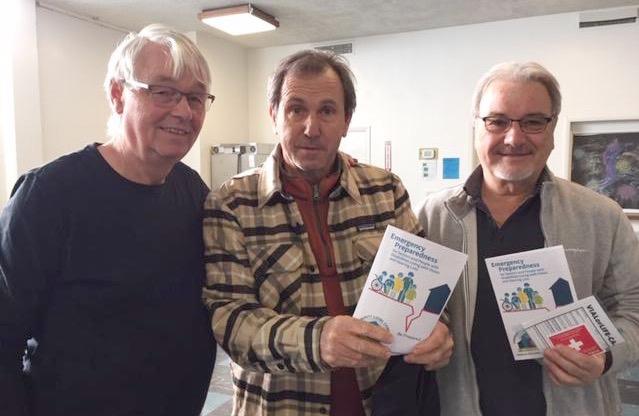 3 men with preparedness brochures