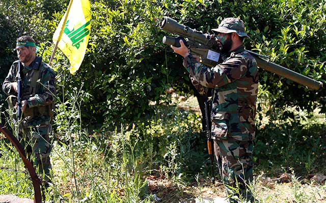 Hezbollah fighters with an Iranian-made anti-aircraft missile.