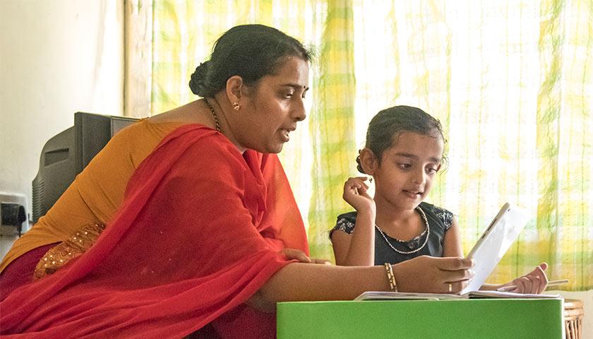 Indian mother homeschooling her child