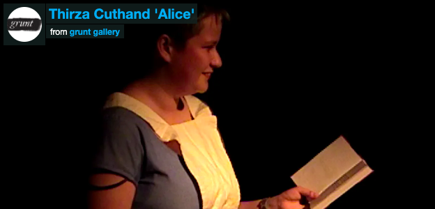 Still from Thirza Cuthand's 'Alice'. Performer reading a book