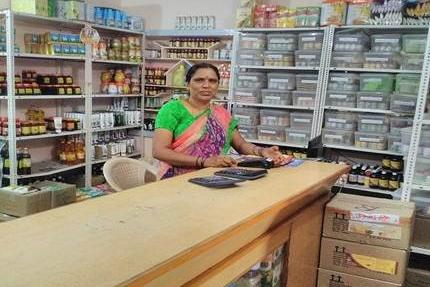 photo of woman shop owner behind counter