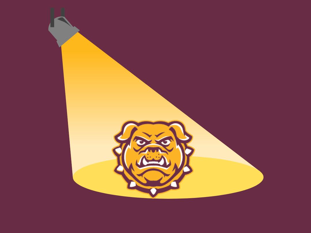 image of a spotlight with bulldog logo in center