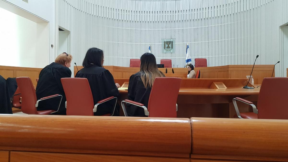 Image: Tebeka attorneys confer in an Israeli courtroom.