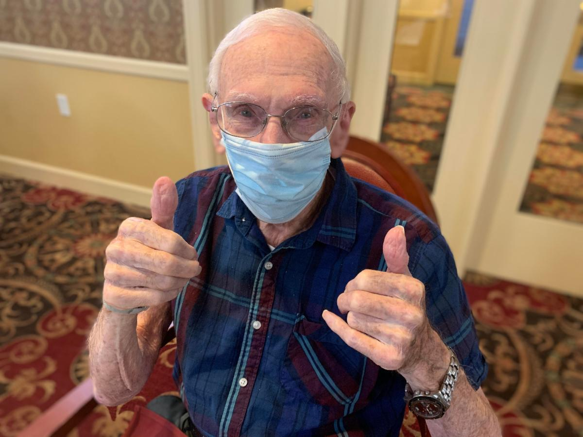 Image: SummerWood resident Arnold Helfand celebrates his first dose of COVID-19 vaccine.