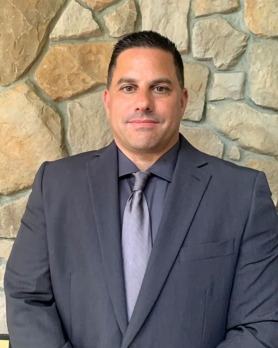 Image: headshot of Communal Security Director John Colangelo