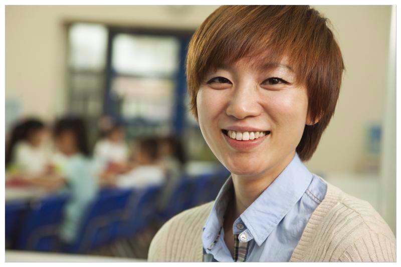 Teacher portrait at lunch in school cafeteria