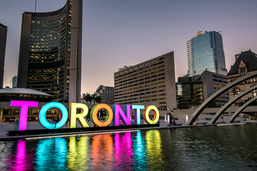 Toronto city hall and Toronto Sign in downtown at twilight_ in Toronto_ Ontario_ Canada