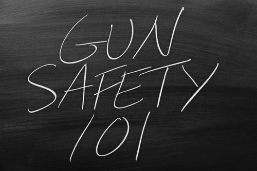 The words  Gun Safety 101  on a blackboard in chalk