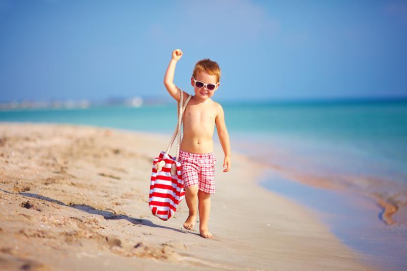 boy_walking_by_ocean.jpg