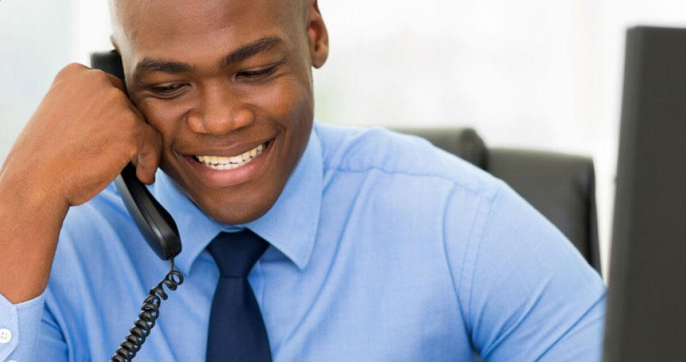 African American business man on phone smiling